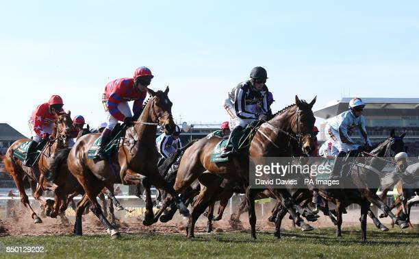 Balthazar King Imperial Commander and Across The Bay in action during the John Smith's Grand National Chase during Grand National Day at Aintree...