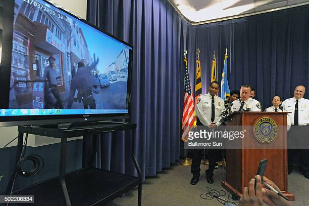 Baltimore City police commissioner Kevin Davis at podium shows a sample of footage from a body camera worn by a police officer during a news...