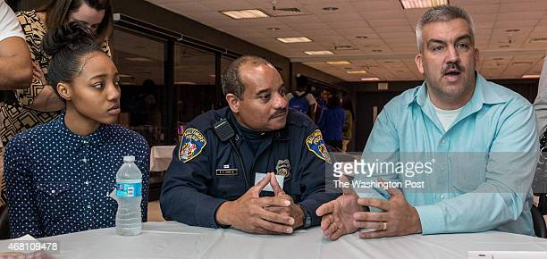 Baltimore City Police Lt James Rhoden [cq] right talks about police relations with AfricanAmerican youth around the Inner Harbor as Shawnna Oram left...