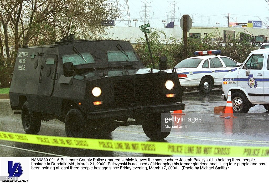 A Baltimore County Police armored vehicle leaves the scene where Joseph Palczynski is holding three people hostage in Dundalk, Md., March 21, 2000. Palczynski is accused of kidnapping his former girlfriend and killing four people and has been holding at least three people hostage since Friday evening, March 17, 2000.