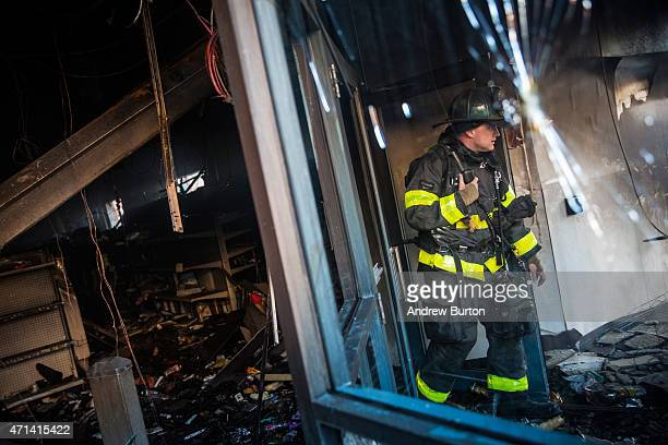 Baltimore firefighters inspect a CVS pharmacy that was burned to the ground yesterday during rioting after the funeral of Freddie Gray on April 28...