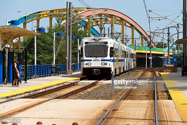 Baltimore Light Rail Train Stopping For Passengers