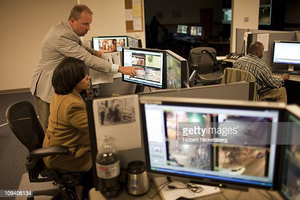 Baltimore Mayor Stephanie RawlingsBlake views closed circuit television screens of high crime locations at the CityWatch Center October 21 2010 in...