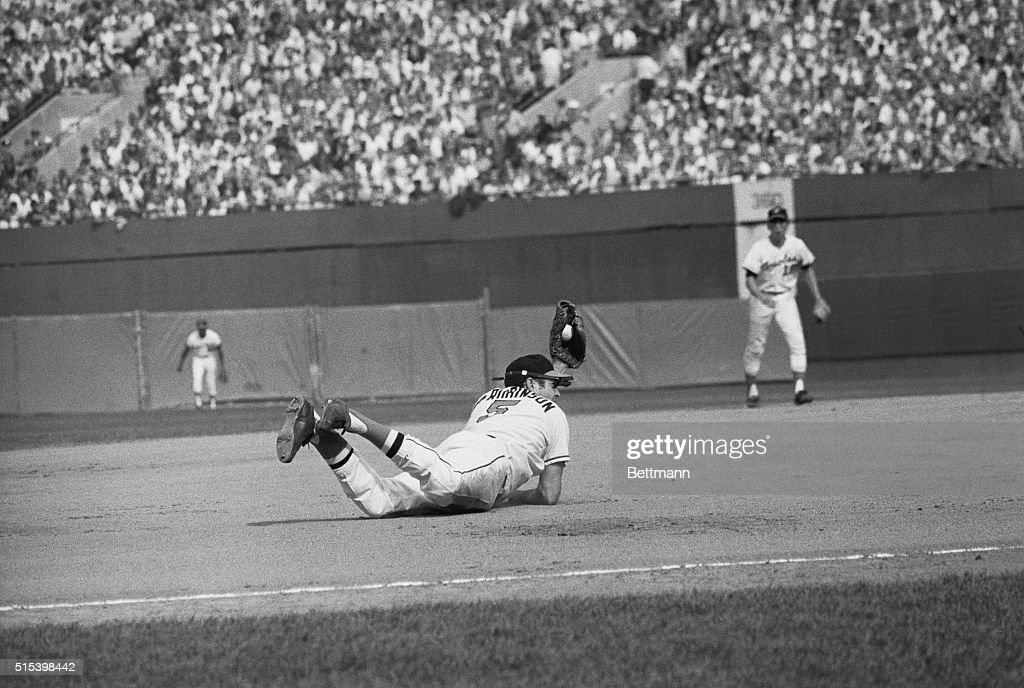 Baltimore's <a gi-track='captionPersonalityLinkClicked' href=/galleries/search?phrase=Brooks+Robinson&family=editorial&specificpeople=213977 ng-click='$event.stopPropagation()'>Brooks Robinson</a> make a diving catch of a line drive by Cincinnati's Johnny Bench in the 5th inning of the 3rd World Series game. The Orioles won, 9-3, giving them a 3-0 lead in the series.