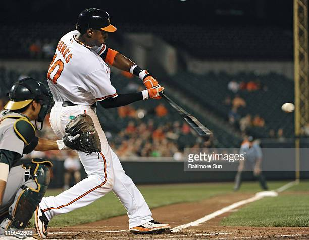 Baltimore Orioles' Adam Jones connects for a solo homer in the sixth inning against the Oakland Athletics at Oriole Park at Camden Yards in Baltimore...