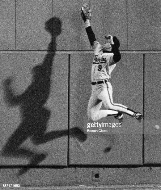 Baltimore Orioles Brady Anderson makes a leaping attempt at a drive hit during a game against the Boston Red Sox at Fenway Park in Boston April 14...