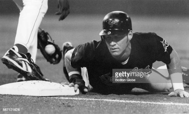 Baltimore Orioles Brady Anderson slides into second base during a game against the Boston Red Sox at Fenway Park in Boston Sept 15 1993