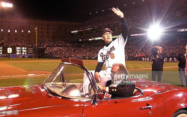Baltimore Orioles Cal Ripken waves to fans during a ride around the stadium in the back of a convertible car after finishing his 3001career and...
