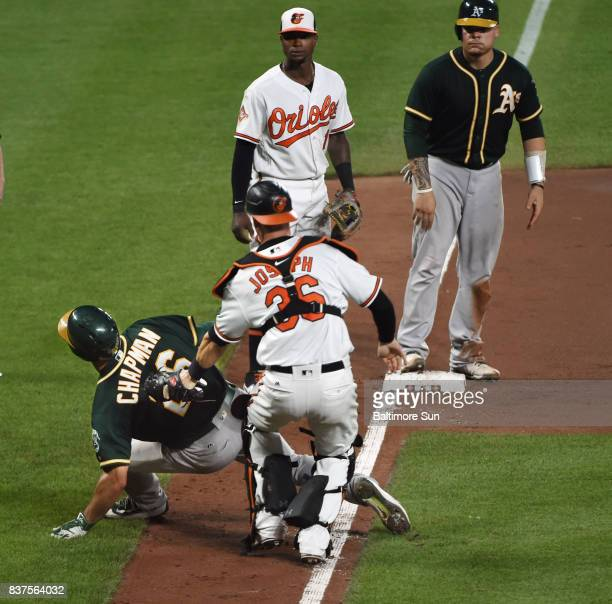 Baltimore Orioles catcher Caleb Joseph center tags out the Oakland Athletics' Matt Chapman left during a rundown in the eighth inning at Oriole Park...