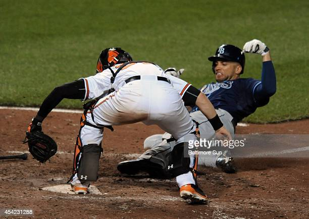 Baltimore Orioles catcher Caleb Joseph forces out Tampa Bay Rays' James Loney on a throw from third baseman Chris Davis with the bases loaded during...