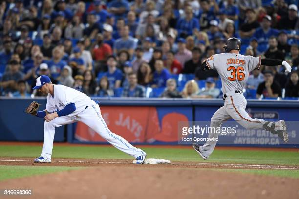 Baltimore Orioles Catcher Caleb Joseph is out as Toronto Blue Jays First base Justin Smoak catches the ball during the MLB regular season game...