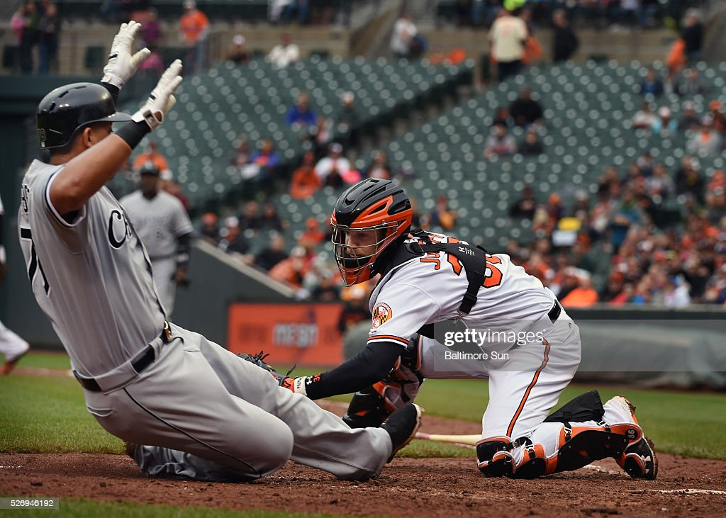 Baltimore Orioles catcher Caleb Joseph tags out Chicago White Sox's Jose Abreu who tries to score on a single by Melky Cabrera during the fifth inning on Sunday, May 1, 2016, at Oriole Park at Camden Yards in Baltimore.