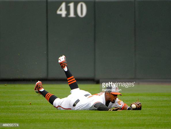 Baltimore Orioles center fielder Adam Jones cannot keep his glove on a ball hit by the Toronto Blue Jays' Jose Reyes in the first inning at Oriole...