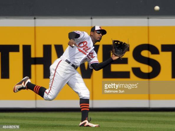 Baltimore Orioles center fielder Adam Jones catches up to a sinking line drive from Minnesota Twins batter Jordan Schafer during the sixth inning on...