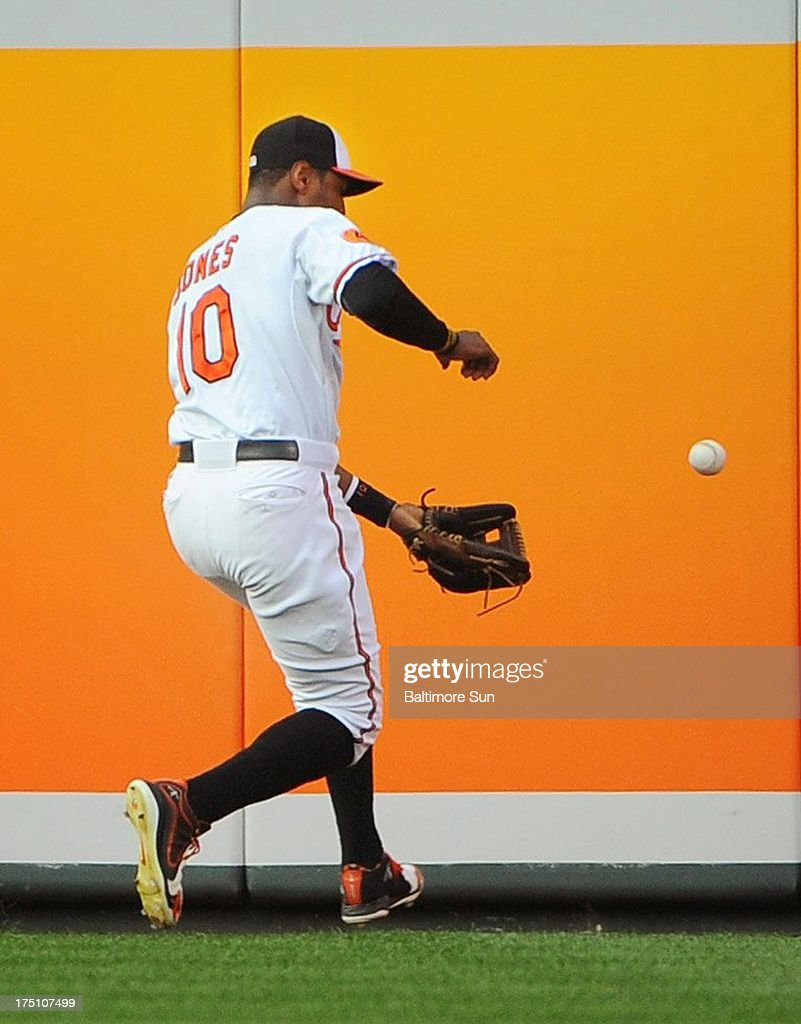 Baltimore Orioles center fielder Adam Jones fields an RBI double by the Houston Astros' Brandon Barnes in the second inning at Oriole Park at Camden Yards in Baltimore, Maryland, on Wednesday, July 31, 2013. The Astros routed the Orioles, 11-0.