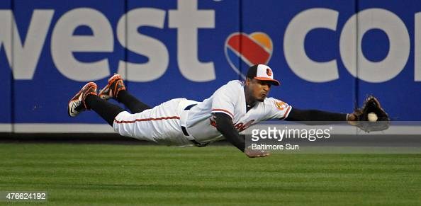 Baltimore Orioles center fielder Adam Jones makes a diving catch to put out the Boston Red Sox's Mookie Betts during the fifth inning on Wednesday...