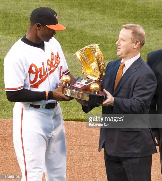 Baltimore Orioles center fielder Adam Jones receives his gold glove for his defensive efforts in the 2009 before the game against the Toronto Blue...