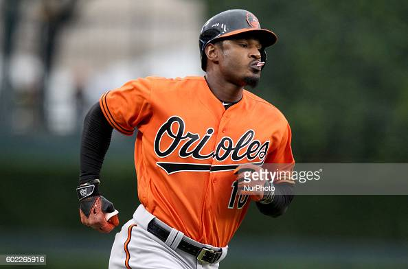Baltimore Orioles center fielder Adam Jones rounds the bases after his single home run in the first inning of a baseball game against the Detroit...