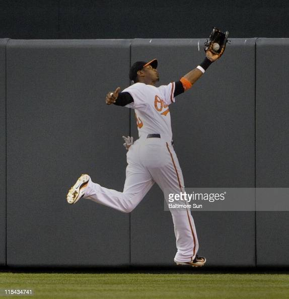 Baltimore Orioles centerfielder Adam Jones catches a ball off the bat of Oakland Athletics' Coco Crisp in the top of the 3rd inning at Oriole Park at...