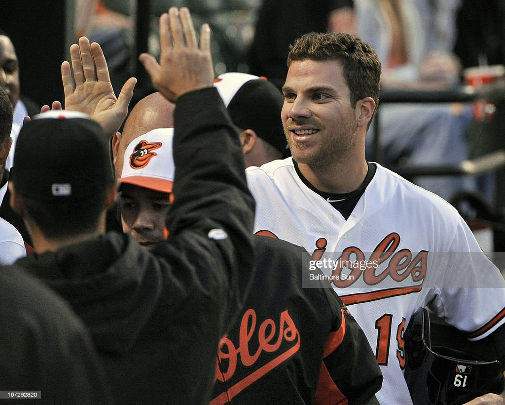 Baltimore Orioles' Chris Davis is congratulated after he scored a run in the 2nd inning against the Toronto Blue Jays in Baltimore, Maryland, Tuesday, April 23, 2013.