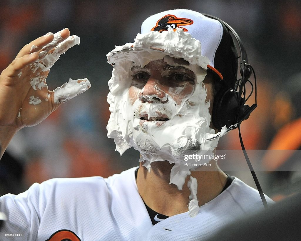 Baltimore Orioles Chris Davis wipes away shaving cream from his face after hitting two home runs against the Washington Nationals at Oriole Park at Camden Yards in Baltimore, Maryland, Wednesday, May 29, 2013. Orioles won, 9-6.