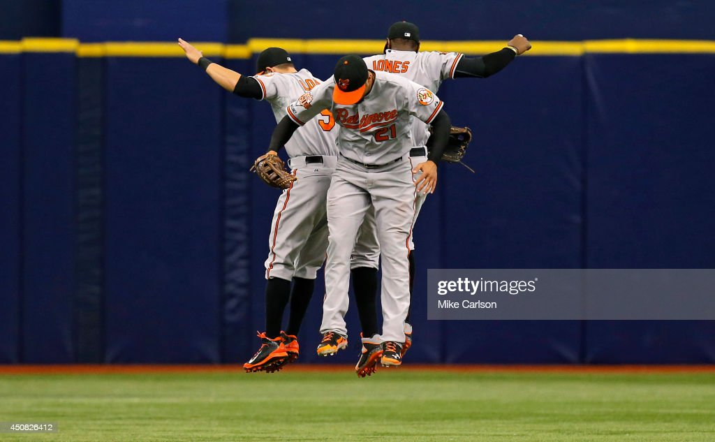 Baltimore Orioles (L-R) <a gi-track='captionPersonalityLinkClicked' href=/galleries/search?phrase=David+Lough&family=editorial&specificpeople=6780100 ng-click='$event.stopPropagation()'>David Lough</a> #9, <a gi-track='captionPersonalityLinkClicked' href=/galleries/search?phrase=Nick+Markakis&family=editorial&specificpeople=614708 ng-click='$event.stopPropagation()'>Nick Markakis</a> #21, and Adam Jones #10 celebrate a win over the Tampa Bay Rays in a baseball game at Tropicana Field on June 18, 2014 in St. Petersburg, Florida.