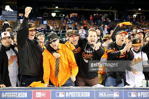 Baltimore Orioles fans celebrate their 2 to 1 win over the Detroit Tigers to sweep the series in Game Three of the American League Division Series at...