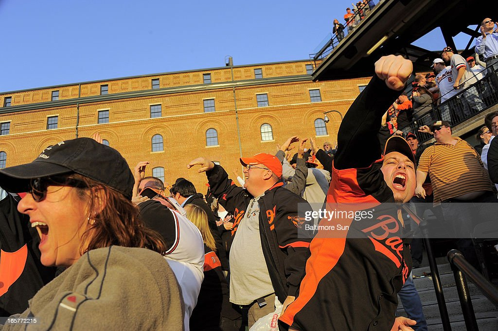 Baltimore Orioles fans erupt as first baseman Chris Davis connects on a grand slam home run in the eighth inning against the Minnesota Twins at Oriole Park at Camden Yards in Baltimore, Maryland, Friday, April 5, 2013. The Orioles defeated the Twins, 9-5.