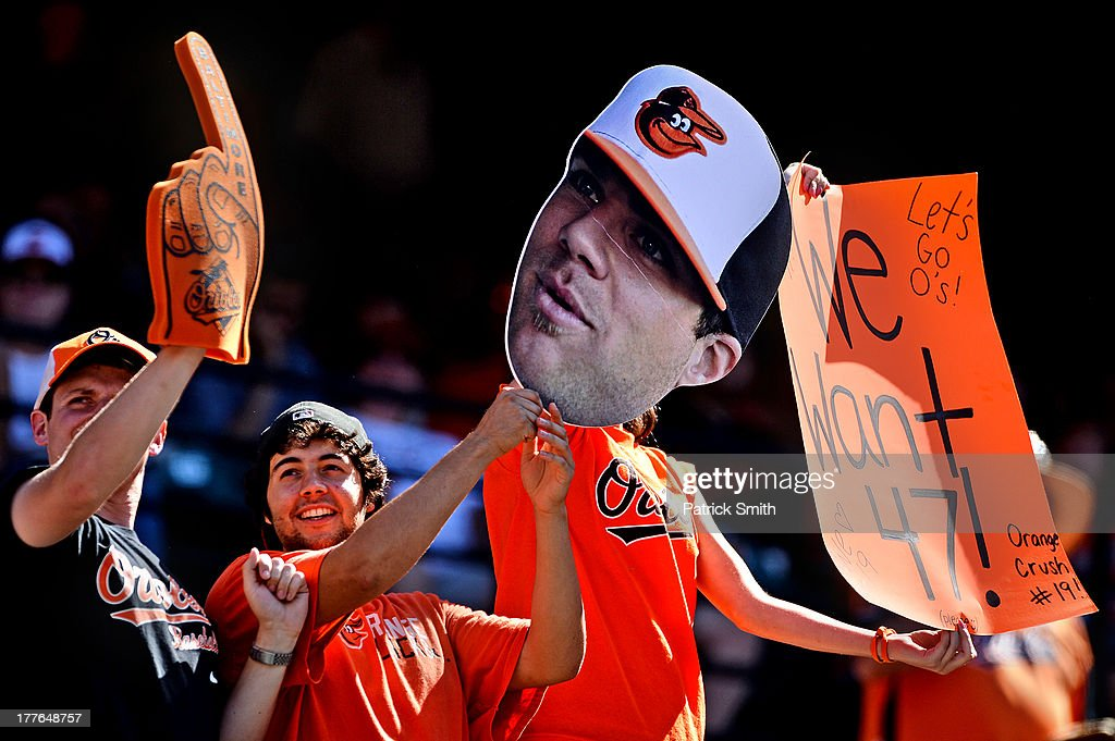 Baltimore Orioles fans hold up signs for Chris Davis of the Baltimore Orioles in support of home run number 47 during an MLB game against the Oakland Athletics at Oriole Park at Camden Yards on August 25, 2013 in Baltimore, Maryland. The Baltimore Orioles won, 10-3.