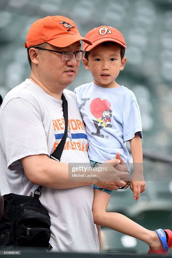 Baltimore Orioles fans watch batting practice before a baseball game against the Tampa Bay Rays at Oriole Park at Camden Yards on June 24, 2016 in Baltimore, Maryland.