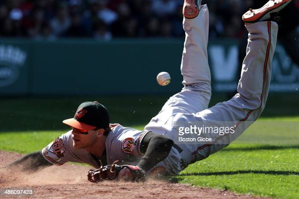 Baltimore Orioles first baseman Chris Davis dives in vain for a foul ball off an attempted bunt by Boston Red Sox catcher David Ross in the seventh...