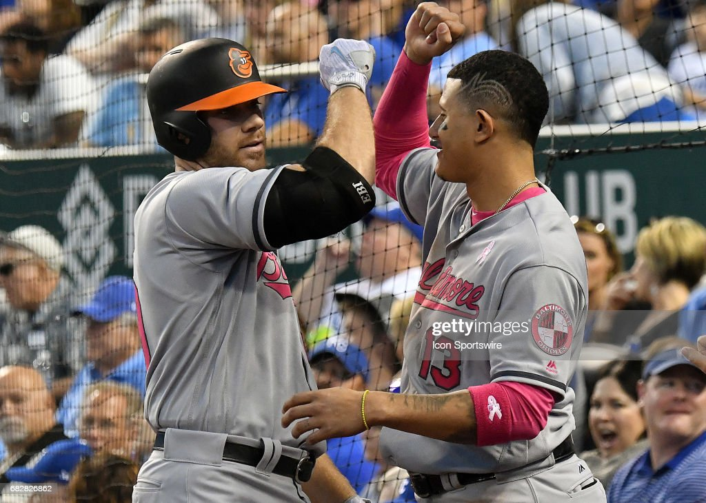 Baltimore Orioles' first baseman Chris Davis (19) is congratulated by Baltimore Orioles' third baseman Manny Machado (13) after he hit a solo home run in the sixth inning during a MLB game between the Baltimore Orioles and the Kansas City Royals, May 13, 2017, at Kauffman Stadium, Kansas City, MO.