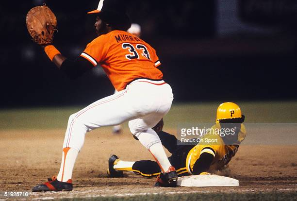 Baltimore Orioles' first baseman Eddie Murray waits for the throw as Pittsburgh Pirates Omar Moreno safely dives back to first during the World...