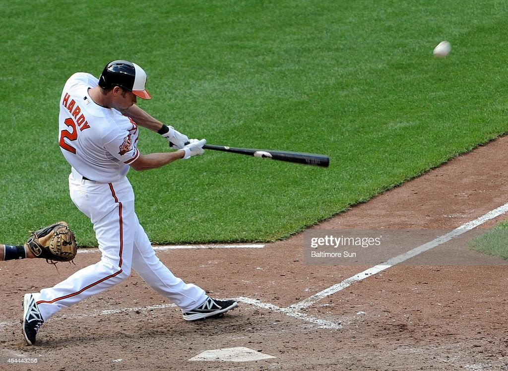 Baltimore Orioles' J.J. Hardy hits a grand slam during the sixth inning on Sunday, Aug. 31, 2014, at Camden Yards in Baltimore.
