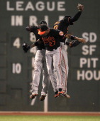Baltimore Orioles left fielder Nate McLouth right fielder Endy Chavez and center fielder Adam Jones celebrate their team's 42 win over the Boston Red...