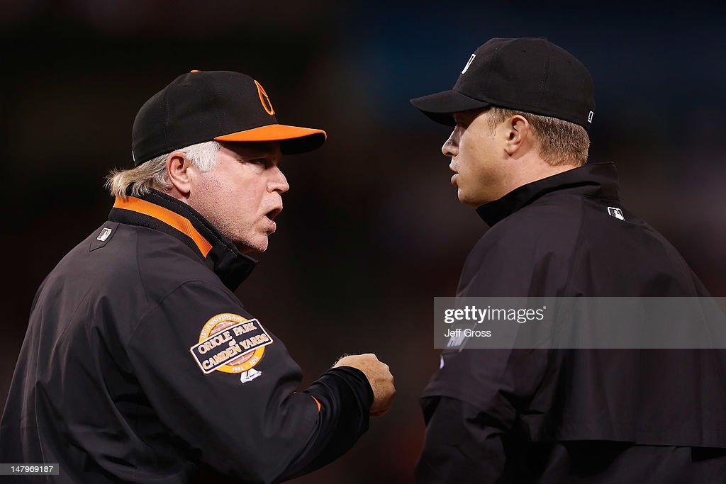 Baltimore Orioles manager Buck Showalter argues with first base umpire Cory Blaser in the fifth inning against the Los Angeles Angels of Anaheim at Angel Stadium of Anaheim on July 6, 2012 in Anaheim, California.