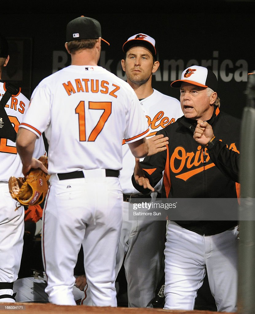 Baltimore Orioles manager Buck Showalter, right, congratulates relief pitcher Brian Matusz (17) after he retired the Kansas City Royals' Mike Moustakas to end the top of the eighth inning at Camden Yards in Baltimore, Maryland, on Wednesday, May 8, 2013. The Orioles won, 5-3.