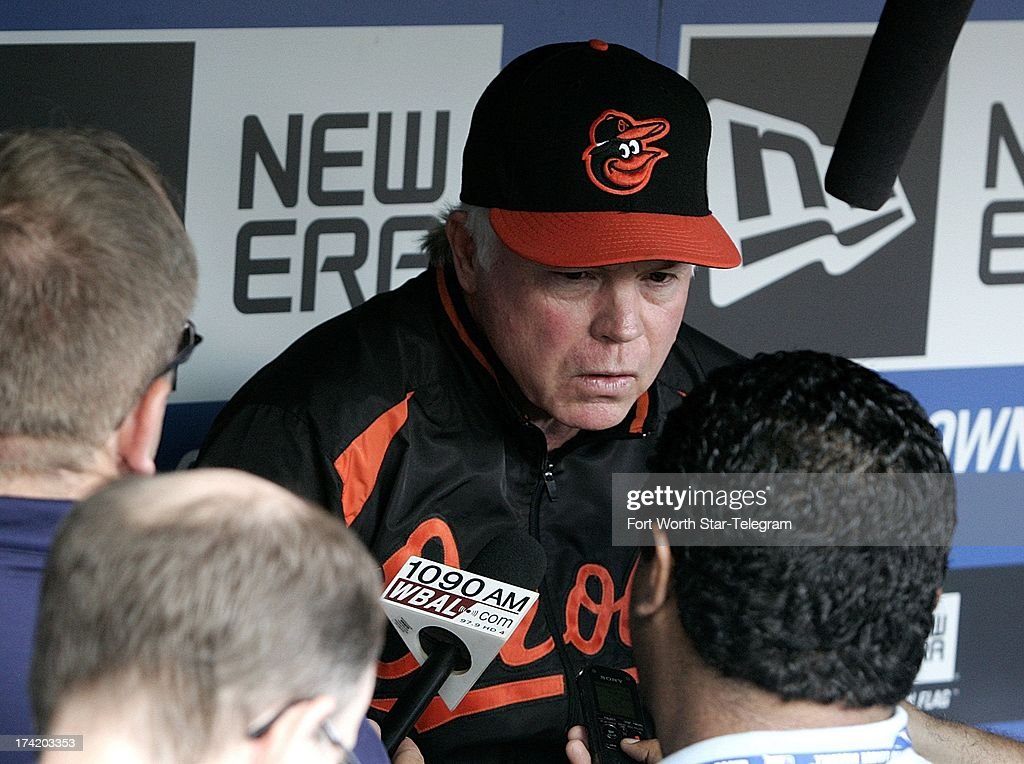 Baltimore Orioles manager Buck Showalter (26) talks with the media before the Baltimore Orioles played the Texas Rangers in a MLB game at Rangers Ballpark in Arlington, Texas, Sunday, July 21, 2013.