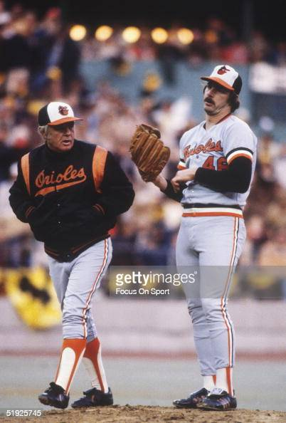 Baltimore Orioles' manager Earl Weaver walks and talks to pitcher Mike Flanagan on the mound during the World Series against the Pittsburgh Pirates...
