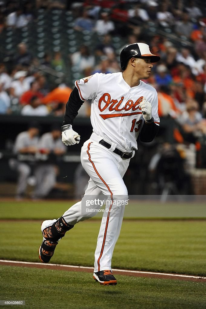 Baltimore Orioles' Manny Machado runs out a fly ball in the first inning against the Boston Red Sox at Oriole Park at Camden Yards in Baltimore on June 10, 2014.