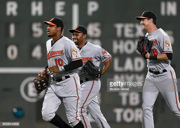 Baltimore Orioles outfielders Adam Jones Michael Bourn and Drew Stubbs head in to join the celebration after the final out of the game The Boston Red...