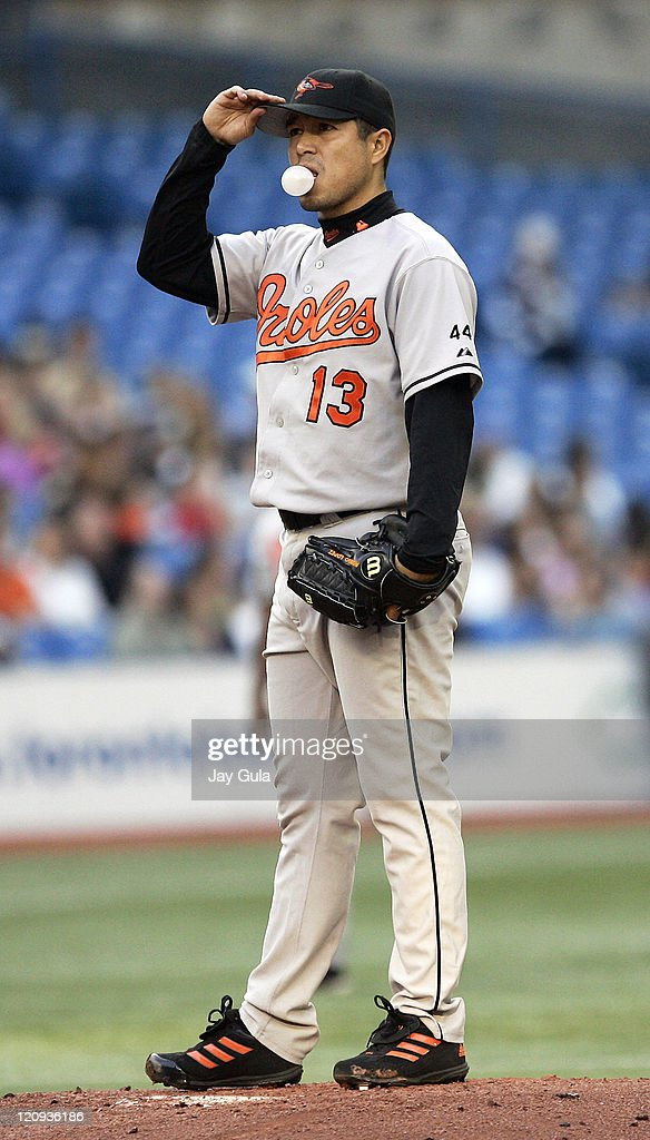 Baltimore Orioles P <a gi-track='captionPersonalityLinkClicked' href=/galleries/search?phrase=Rodrigo+Lopez&family=editorial&specificpeople=216384 ng-click='$event.stopPropagation()'>Rodrigo Lopez</a> blows a bubble and adjusts his cap after surrendering 3 runs in the 1st inning during tonight's game vs the Toronto Blue Jays at Rogers Centre in Toronto, Canada June 14, 2006.