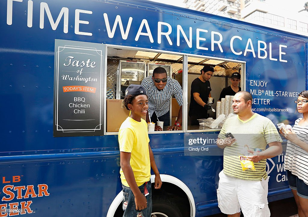 Baltimore Orioles player Adam Jones (C) attends Time Warner Cable MLB All Star Week - Food Trucks, Wifi & Players on July 15, 2013 in New York City.