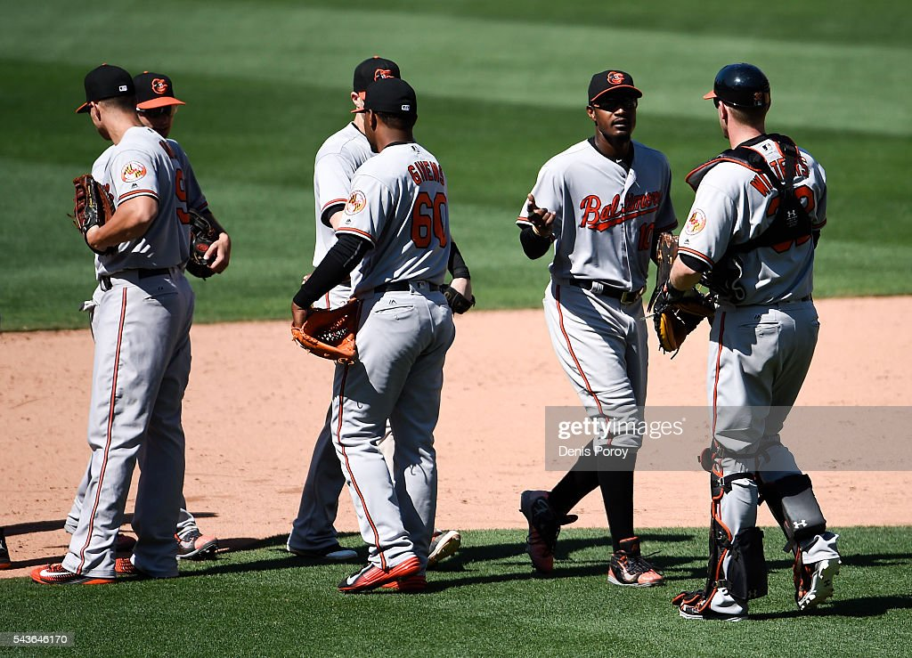 Baltimore Orioles players high-five after beating the San Diego Padres 12-6 in a baseball game at PETCO Park on June 29, 2016 in San Diego, California.