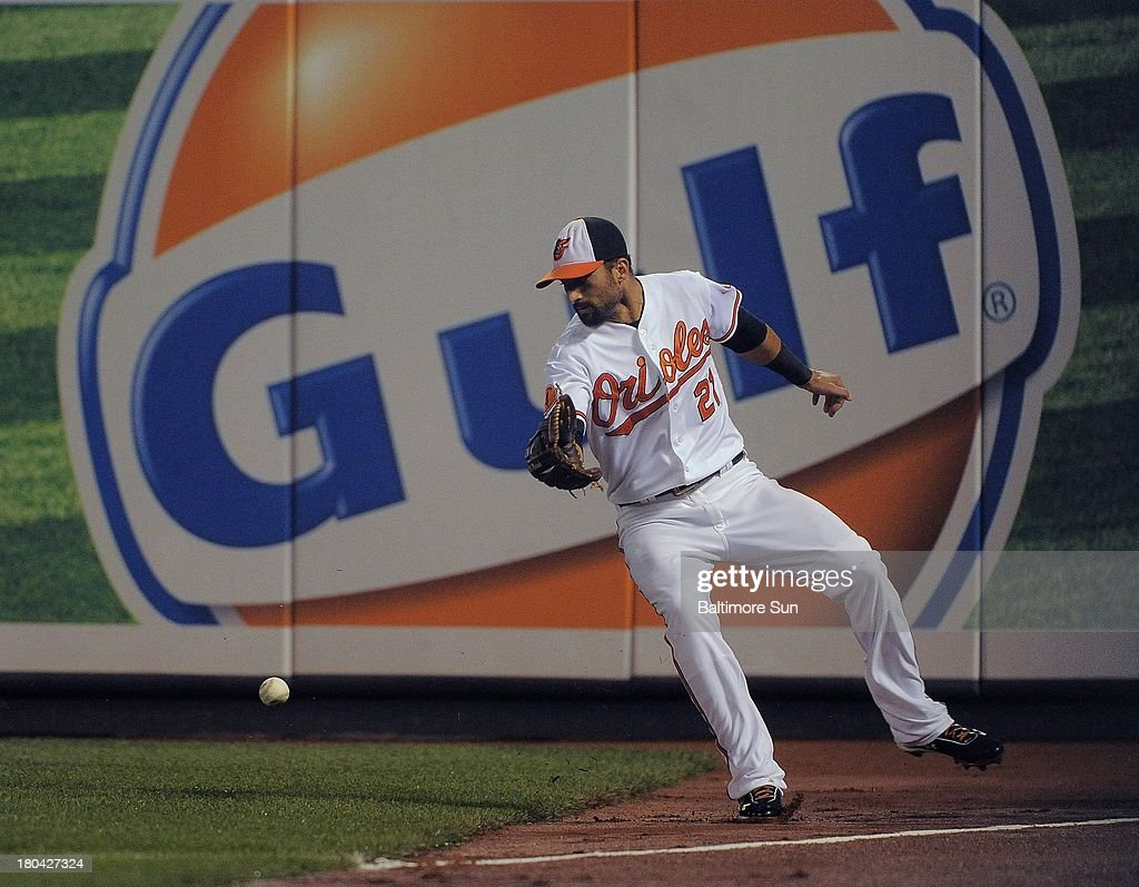 Baltimore Orioles right fielder Nick Markakis (21) overruns a drive, hit by New York Yankees' Alfonso Soriano, during the third inning at Oriole Park at Camden Yards in Baltimore, Maryland, Thursday, September 12, 2013.