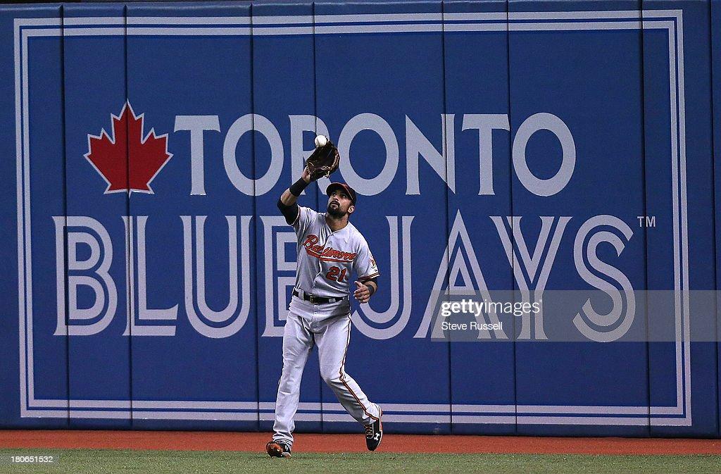 TORONTO, ON- SEPTEMBER 15 - Baltimore Orioles right fielder Nick Markakis tracks down a Rajai Davis fly ball as the Toronto Blue Jays lose the Baltimore Orioles 3-1 at Rogers Centre in Toronto, September 15, 2013.