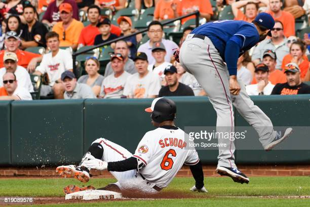 Baltimore Orioles second baseman Jonathan Schoop slides safely into first base under the tag of Texas Rangers first baseman Joey Gallo during an MLB...