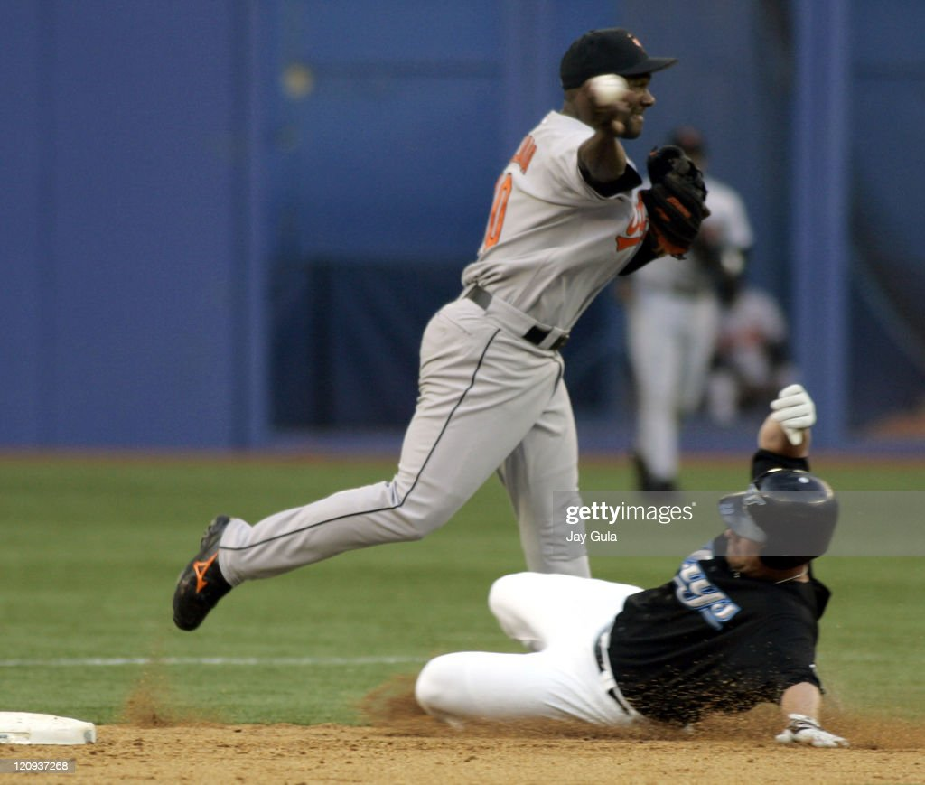 Baltimore Orioles shortstop <a gi-track='captionPersonalityLinkClicked' href=/galleries/search?phrase=Miguel+Tejada&family=editorial&specificpeople=202227 ng-click='$event.stopPropagation()'>Miguel Tejada</a> completes a double play over a sliding Shea Hillebrand in MLB action at the Rogers Centre in Toronto on June 23, 2005.