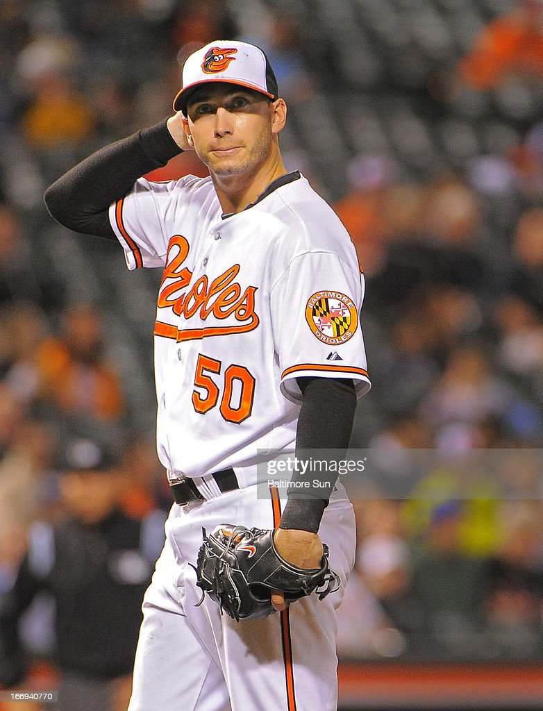 Baltimore Orioles starting pitcher Miguel Gonzalez reacts after yielding a home run to the Tampa Bay Rays' Jose Molina in the sixth inning at Oriole Park at Camden Yards on Thursday, April 18, 2013, in Baltimore, Maryland. The Orioles won, 10-6, in 10 innings.
