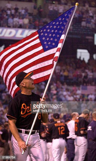 Baltimore Orioles third baseman Cal Ripken looks up to an American flag as he takes the field at Camden Yards 21 September in Baltimore for a...